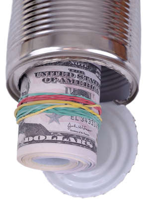 Bundle of notes in tin can. Stock Photo