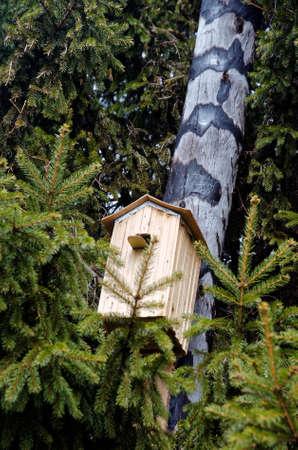 A birdhouse on a wooden column. Stock Photo