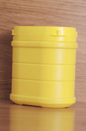 Yellow plastic container Фото со стока