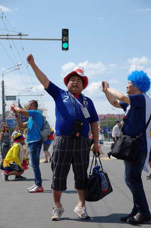 SARANSK, RUSSIA - JUNE 19, 2018: Japanese football fans before football match between Columbia vs. Japan.