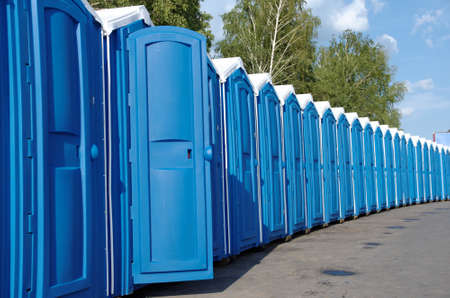 A line of portable toilets.