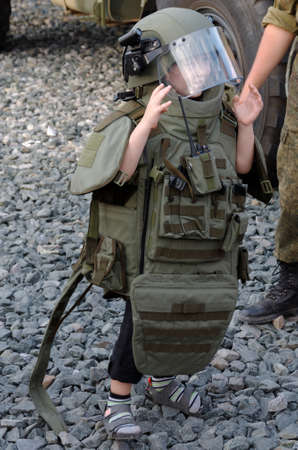 SARANSK, RUSSIA - JUNE 30, 2018: A boy in bulletproof vest.