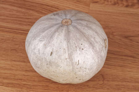 White pumpkin on table.