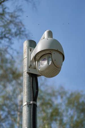 A surveillance camera, aimed at a public street. Stok Fotoğraf