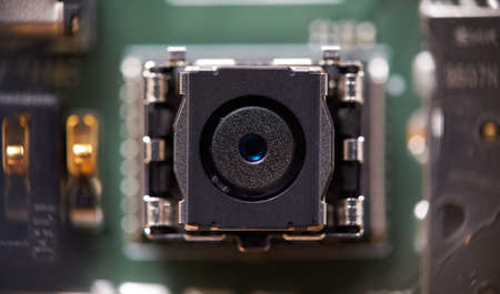 Camera module on smartphone PCB. 免版税图像