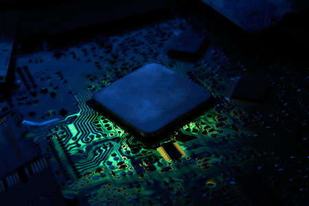 Central processor unit at printed circuit board. Low-key photo.