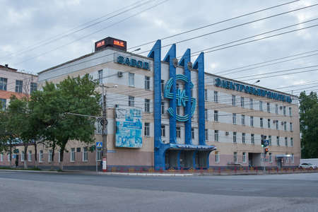 Saransk, Russia - June 01, 2021: The main building of the Elektrovypryamitel plant in Saransk. There is a huge diode symbol on the facade of the building. Redactioneel