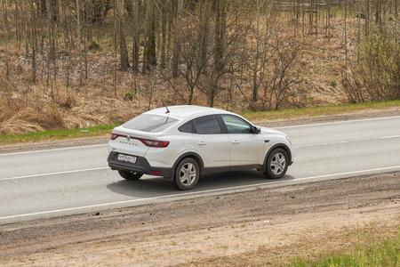 Ruzayevsky District, Mordovia, Russia - May 08, 2021: The Renault Arkana on the intercity road. Editorial