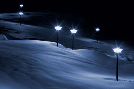 Lights in snow on hill  photo