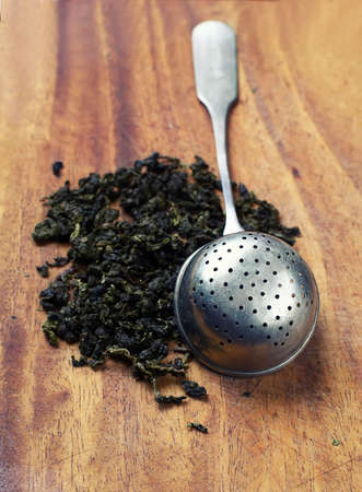 strainer: ? strainer with green tea. Stock Photo