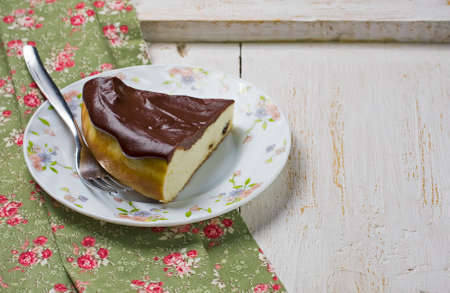 lunch tray: Piece of cheese casserole with chocolate glaze