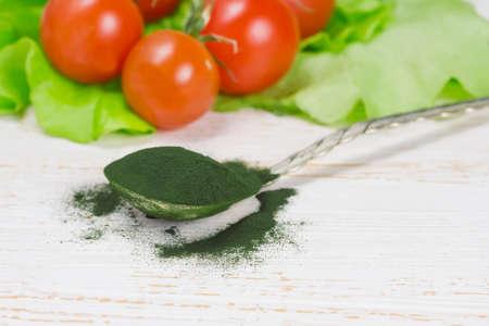 algae: Spirulina powder - algae, nutritional supplement in spoon