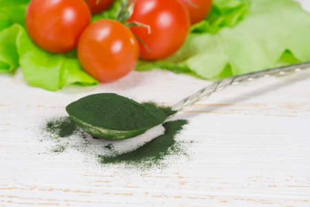 Spirulina powder - algae, nutritional supplement in spoon
