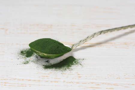 supplement: Spirulina powder - algae, nutritional supplement in spoon