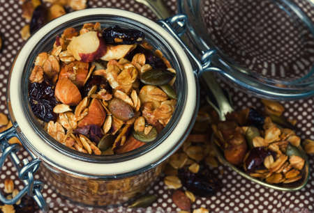 Healthy homemade granola with nuts and dried cranberries. Granola