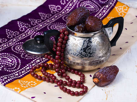 Dates fruit and rosary still life