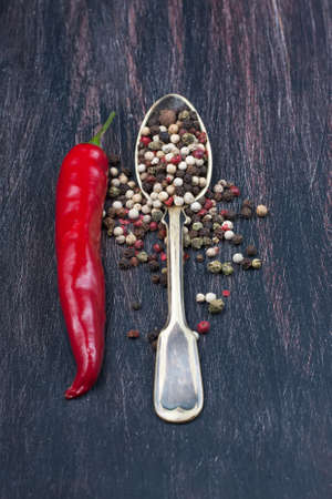red chilly: colored peppers mix, red chilly peppers  on a wooden table,  selective focus Stock Photo