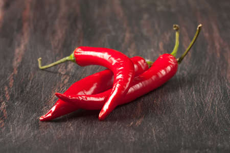 red chilly peppers  on a wooden table