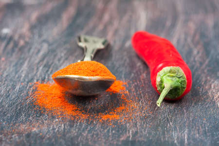 red chilly: red chilly peppers  on a wooden table,  selective focus