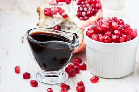 pomegranate sauce, on white background. Selective focus Banque d'images
