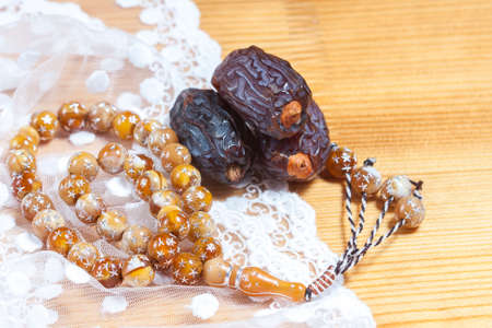 Dates  with islamic rosary. Selective focus