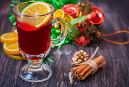 punch spice: Hot wine (mulled wine) with spices on wooden background. Selective focus.
