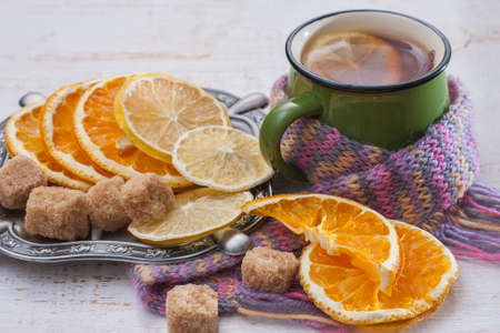 convalesce: Orange and lemon slices on old wooden table. Winter time. Selective focus Stock Photo