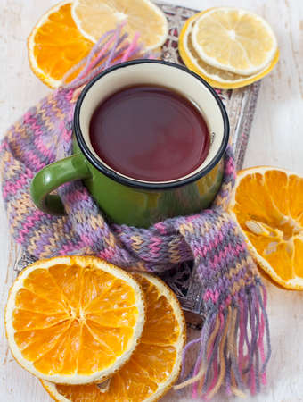 convalesce: Сup of hot tea with and scarf.  Selective focus