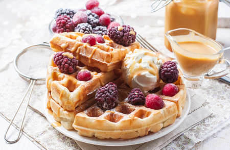 Belgian waffles with caramel and ice cream. Selective focus