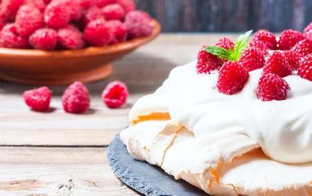 Homemade cake Pavlova with whipped cream and fresh raspberry. Selective focus
