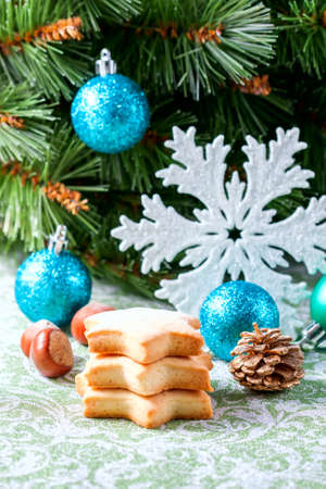 Homemade star shaped cookies on a wooden background. Christmas decoration. Selective focus
