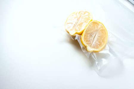lemon in a vacuum package. Sous-vide, new technology cuisine. Sous-vide. Selective focus Stock Photo