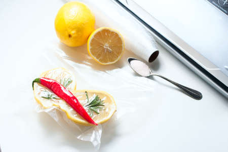 poaching: lemon in a vacuum package. Sous-vide, new technology cuisine. Sous-vide. Selective focus Stock Photo