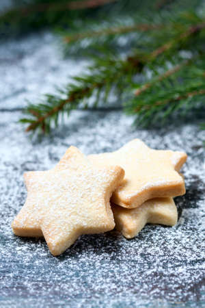 pastry cutters: Homemade star shaped cookies on a wooden background. Christmas decoration. Selective focus