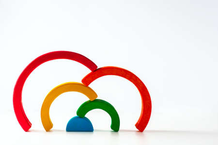 Rainbow, multicolored wooden eco toy. Isolated on white