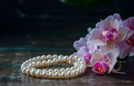 jewerly: Pink orchid with a pearl necklace