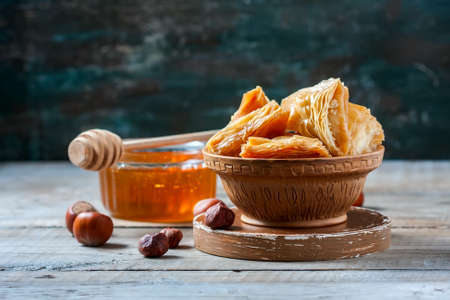 Traditional arabic dessert Baklava with honey and nuts, selective focus