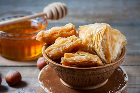 baklava: Traditional arabic dessert Baklava with honey and nuts, selective focus