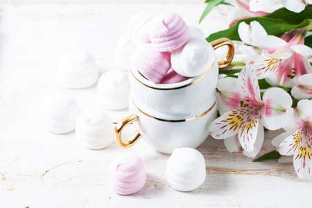 Delicious white and pink marshmallows in cup. Selective focus Stock Photo