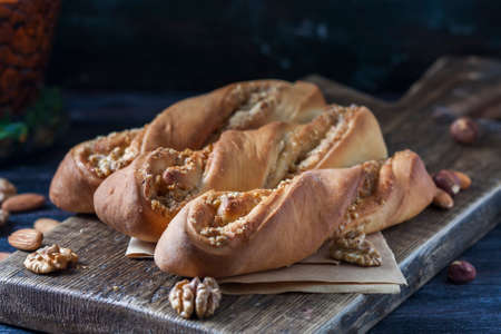 Sweet homemade rolls stuffed with walnut. Selective focus. Stock Photo