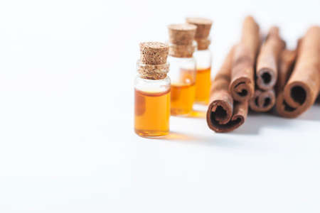 bath essence: Essential oil cinnamon in glass bottle. Spa concept. Selective focus. Stock Photo
