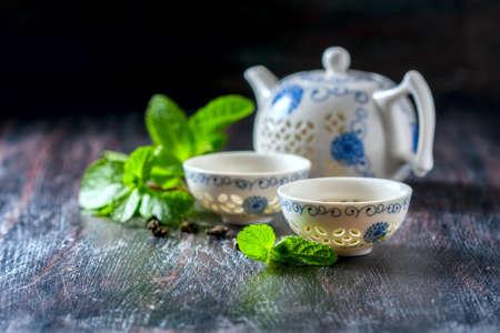 Chinese tea set, green tea and fresh mint. Selective focus Stock Photo
