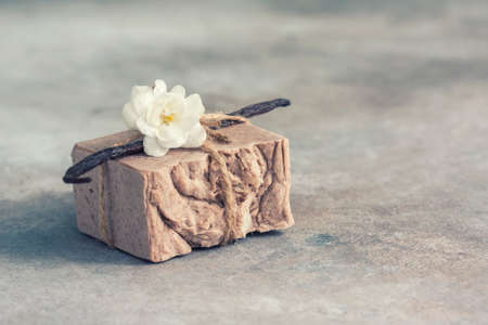 Organic handmade soap with vanilla on a concrete background, spa concept.