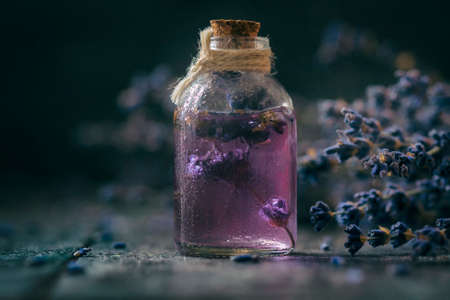 Concept spa therapy. Fresh lavender blossoms with Natural handmade lavender oil, sea salt. Selective focus.