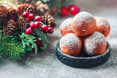 Sweet donuts from cottage cheese with powdered sugar. Christmas installation. Place for text. Selective focus