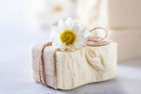 Natural handmade soap with chamomile, the concept of spa and health.