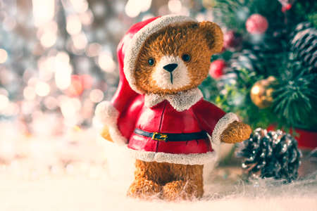 santa teddy bear christmas decorations on a white background selective focus stock photo