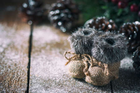 Christmas background with decorations on a Christmas tree handmade, winter boots. Soft focus. Festive still life Stock Photo