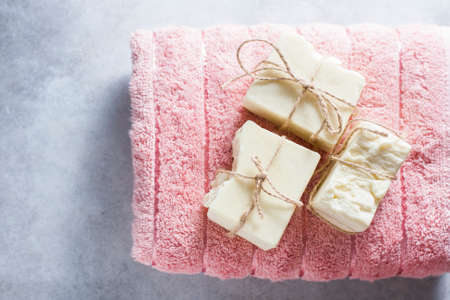 Organic handmade natural soap on a towel. The concept of the resort. Selective focus Stock Photo