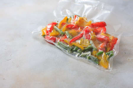 Vegetables in sealed vacuum packing bags. Su-video cooking. Selective focus